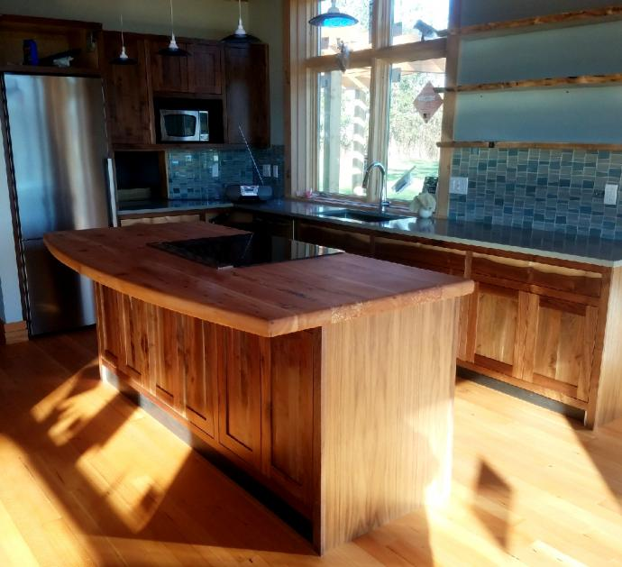 Walnut cabinetry utilized a mixture of Reclaimed Walnut and board stock from a walnut tree which was removed from the build site.