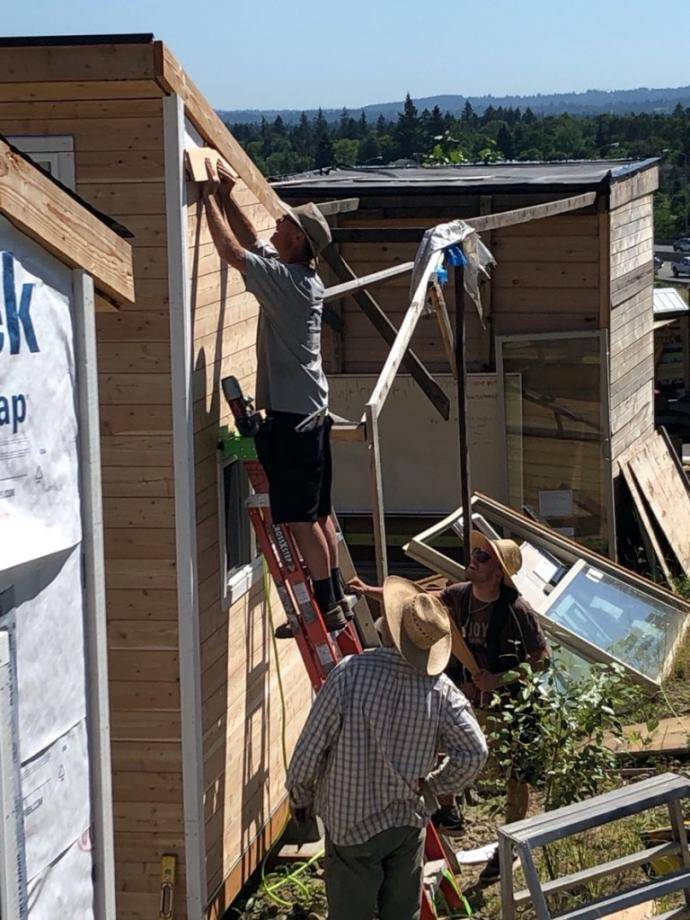 Installation of Pioneer Millworks Exterior Select Larch Siding at the Agape Village in Oregon.