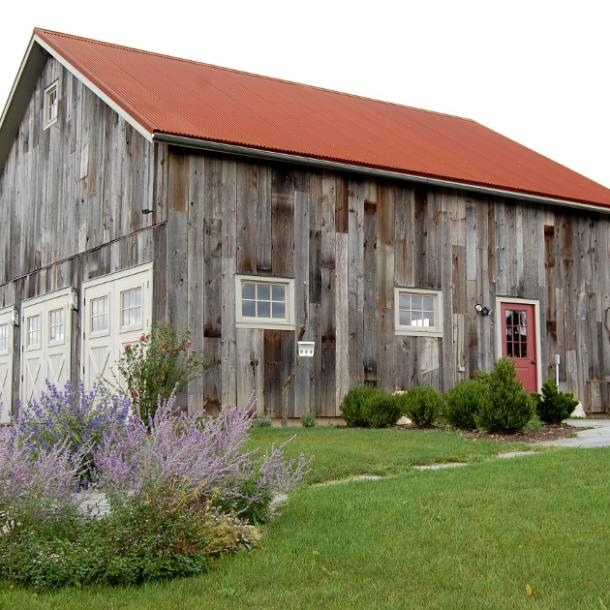 Pioneer Millworks reclaimed and sustainable wood exterior siding products featuring American Prairie Weathered Grey