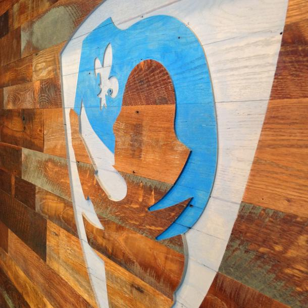 Settlers' Plank Mixed Oak wall paneling, cut with a CNC of the credit union's logo done by our sister company NEWwoodworks