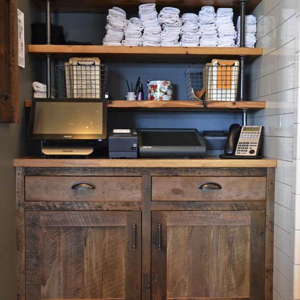 Settlers' Plank Mixed Hardwoods form the cashier station off the main dining area in Kindred Fare.