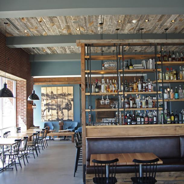 Reclaimed softwoods t&g ceiling joins other reclaimed wood tables, fixtures, cabinetry, doors, and more in Kindred Fare.