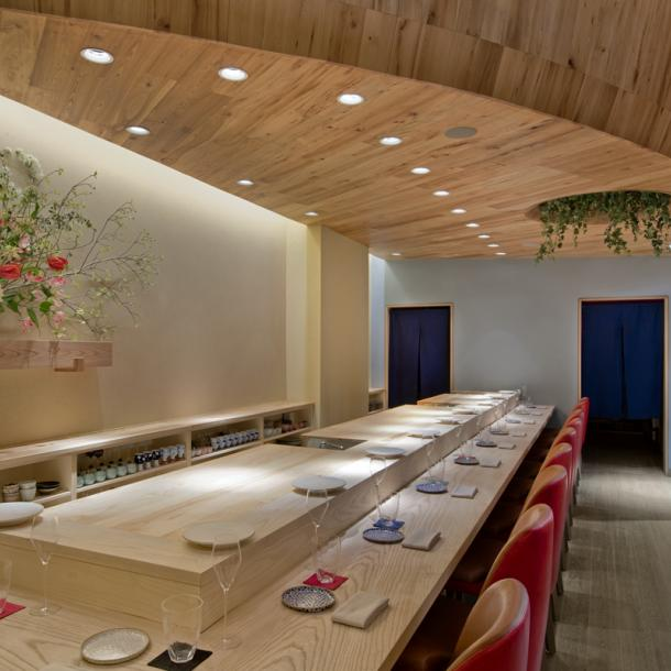 This sushi bar in New York City has American Gothic Elm ceilings and American Gothic White Oak reclaimed wood floors with a custom grey finish. Photo by Connie Zhou.