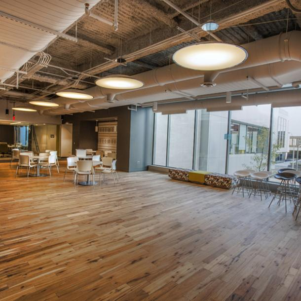 Pioneer Millworks American Gothic Hickory reclaimed wood flooring in an office space in Rochester, NY