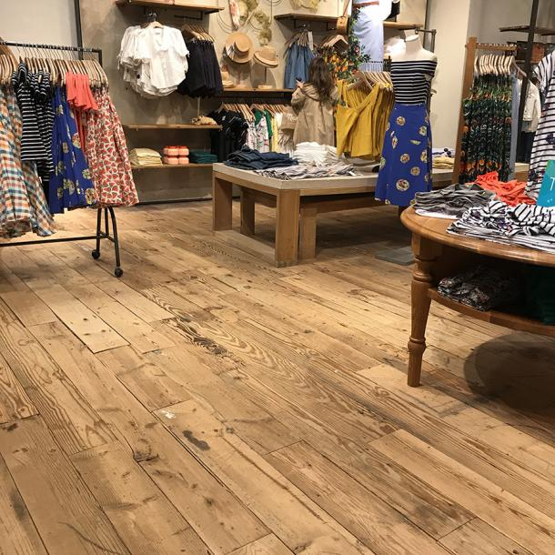Pioneer Millwork reclaimed softwoods custom mix floor in Anthropologie, Natick, MA.