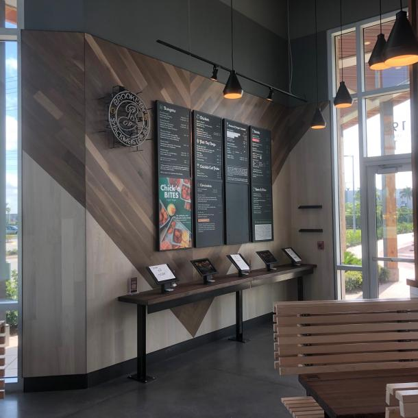 Pioneer Millworks Modern Farmhouse Walnut and Modern Farmhouse Ash with Poly finish and Fire Retardant in Shake Shack Sarasota, FL.