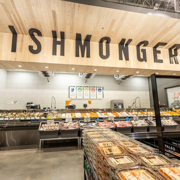 Pioneer Millworks Whole Modern Farmhouse Clean Ash paneling with poly and fire retardant in Whole Foods, Atlanta, GA