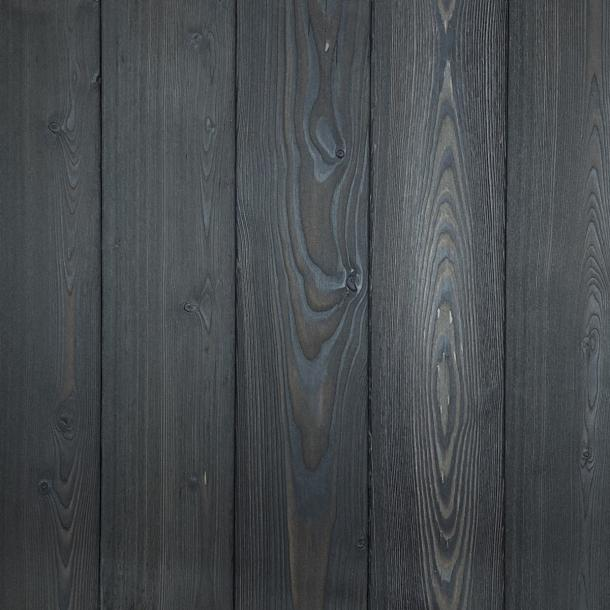 Shou Sugi Ban Larch Charcoal by Pioneer Millworks. Charred wood siding and paneling that is burned, brushed twice, and coated with an exterior oil