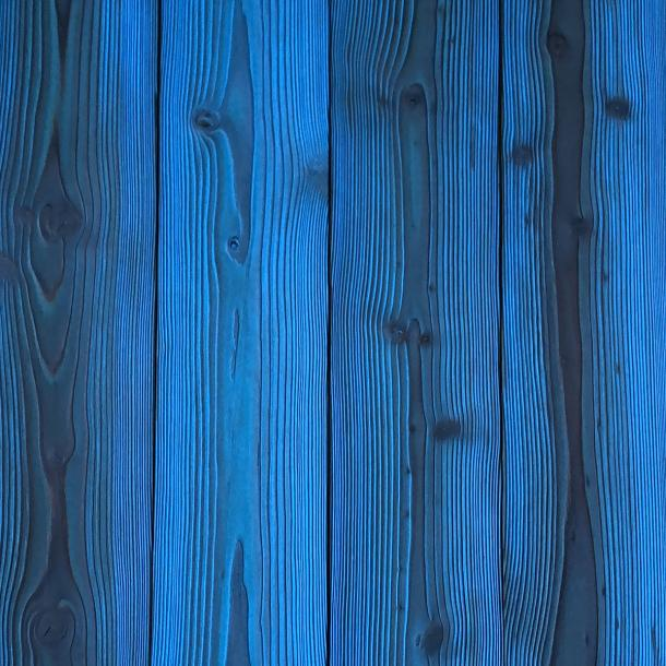 Shou Sugi Ban Larch Cobalt by Pioneer Millworks. Charred wood siding and paneling that is burned, brushed twice, and coated with an exterior oil