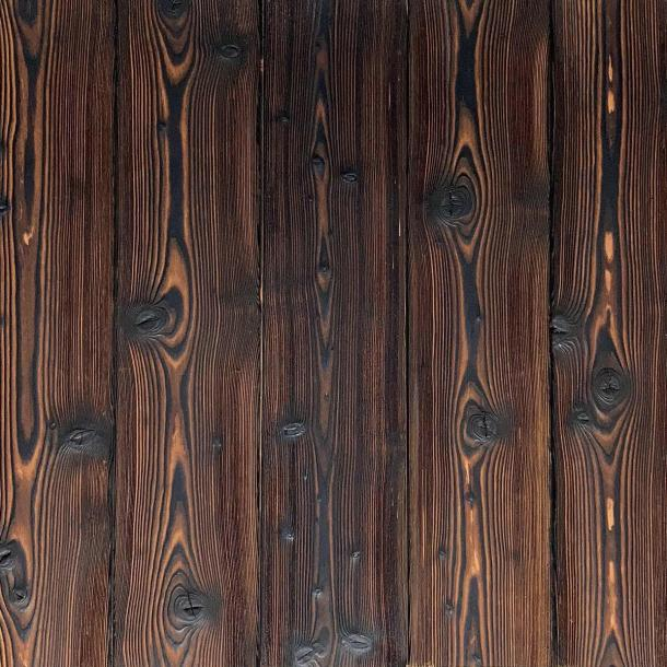 Shou Sugi Ban Larch Toasted | 2 by Pioneer Millworks. Charred wood siding and paneling that is burned, brushed twice, and coated with an exterior oil