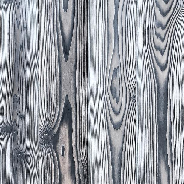 Shou Sugi Ban Larch White by Pioneer Millworks. Charred wood siding and paneling that is burned, brushed twice, and coated with an exterior oil