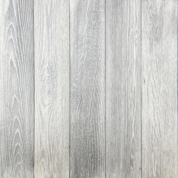 Shou Sugi Ban Oak White by Pioneer Millworks. Charred wood paneling that is burned, brushed once, and coated with non-toxic, water-based polyurethane