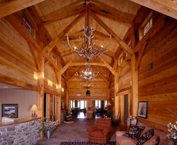 The reception area at Bristol Harbor Resort off Canandaigua Lake welcomes visitors in an industrial salvaged timber frame.