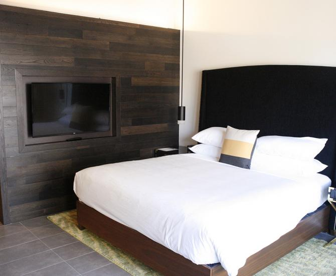 American Gothic Mixed Oak reclaimed wood wall paneling in the guest rooms of Hi-Lo Hotel in Portland, OR.