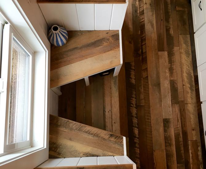 Pioneer Millworks Settlers Plank Mixed Hardwoods reclaimed wood flooring in a tiny home in Portland, OR