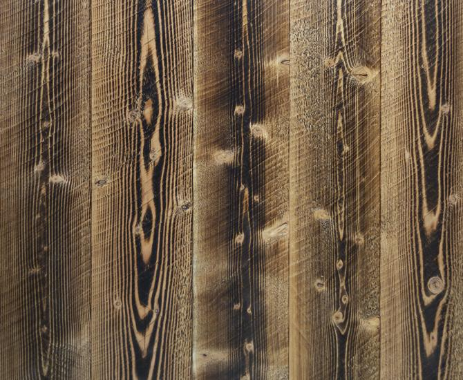 Shou Sugi Ban Larch Shallow Char by Pioneer Millworks. Charred wood siding and paneling that is burned with a circle sawn texture
