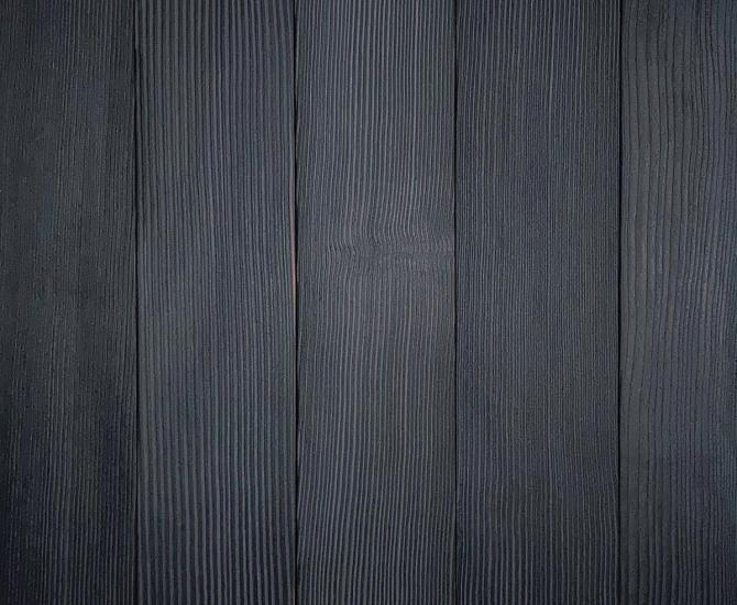 Shou Sugi Ban Douglas Fir Charcoal by Pioneer Millworks. Charred wood siding and paneling that is burned, brushed twice, and coated with an exterior oil