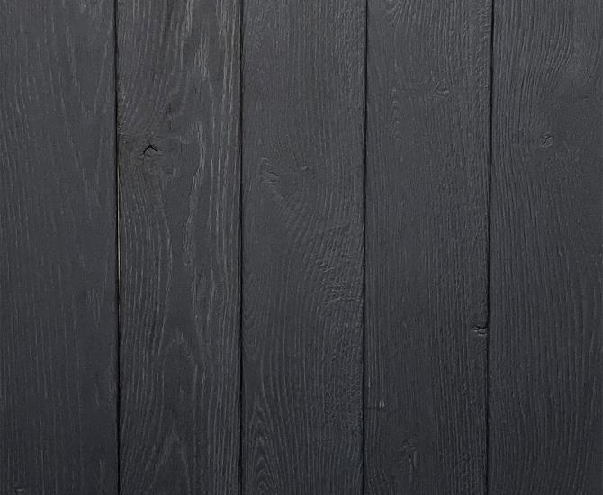 Shou Sugi Ban Oak Charcoal by Pioneer Millworks. Charred wood paneling that is burned, brushed twice, and coated with an exterior oil